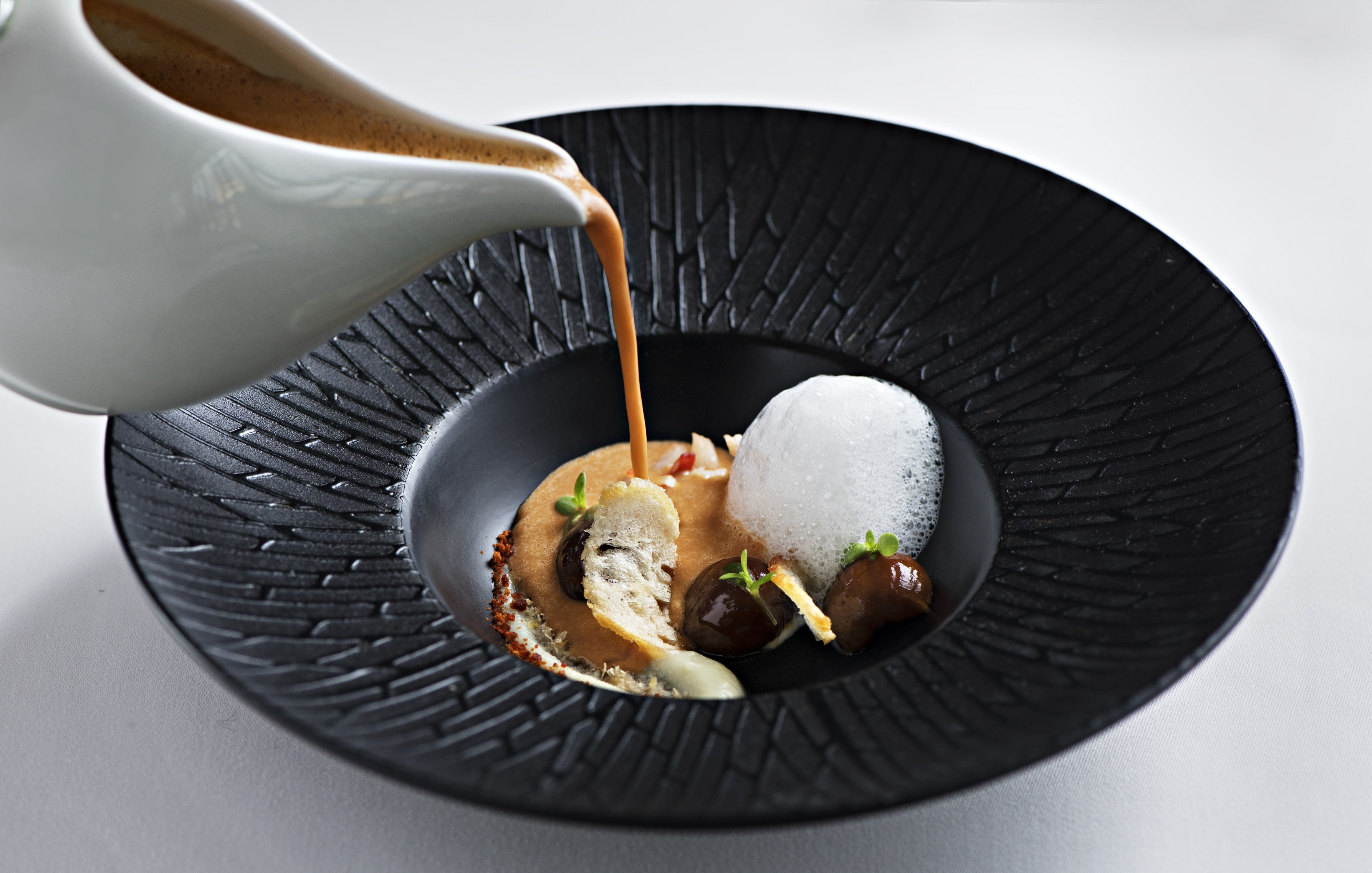 Lobster and chestnut bisque with sweet garlic emulsion and savory -ซุปล็อบสเตอร์บิสค์