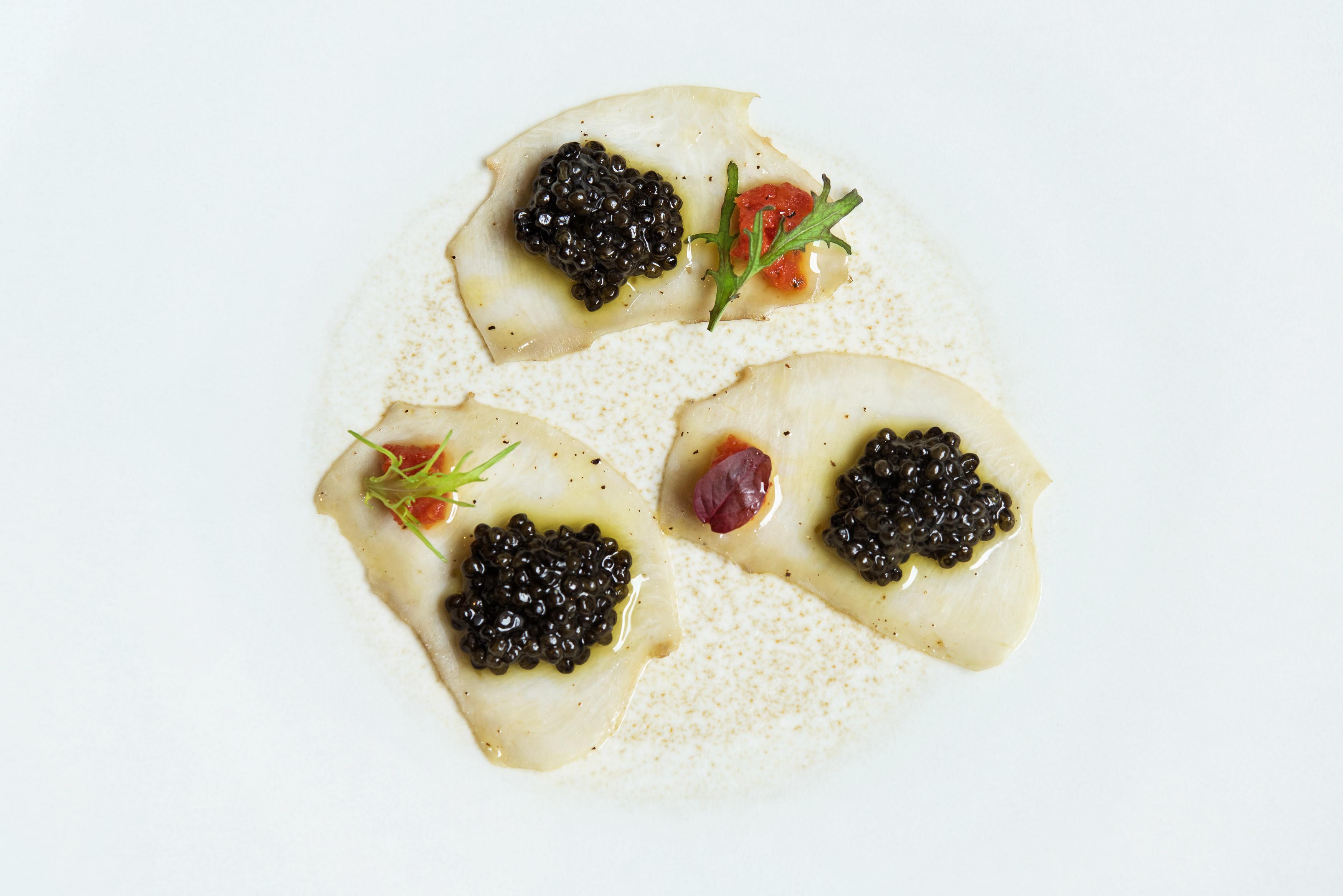 Confit Abalone Carpaccio, sweet pepper and semi-dried tomato, oscietra caviar